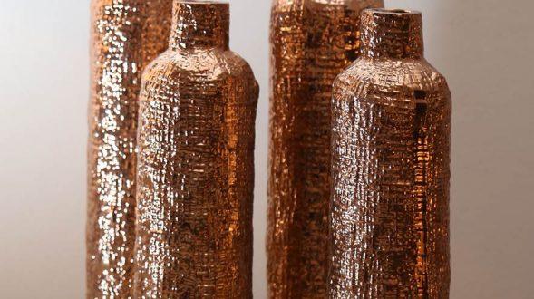 Botellones laminados en cobre. 14