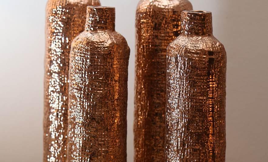 Botellones laminados en cobre. 31