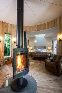 2.6craftycamping-thewoodsmanstreehouse-rotating-fire-bedroom (Copy)