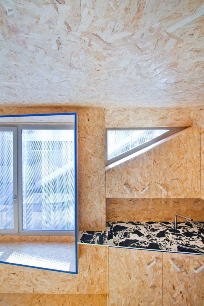 """Una """"Cabina urbana"""" con un toque persa en 25 m2 20"""