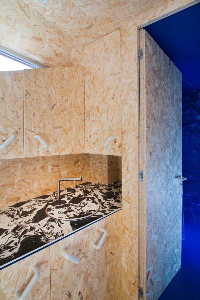 """Una """"Cabina urbana"""" con un toque persa en 25 m2 21"""